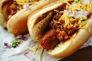 Canvas Prints Chicago Homemade Chili dogs topped with cheddar cheese, selective focus