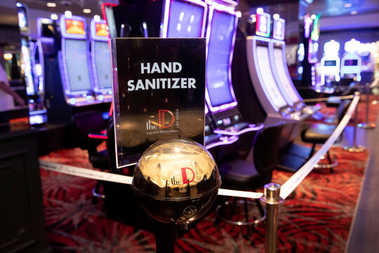 Hand sanitizer is shown by slot machine ahead of the June 4 reopening of The D casino in downtown Las Vegas