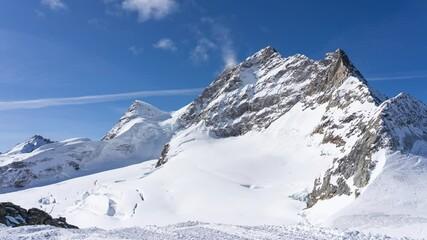 Wall Mural - Jungfrau with blue nice sky in Switzerland