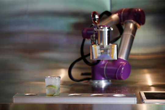 Drink Bot makes a cocktail as a measure to minimise human contact to avoid the spread of the coronavirus disease (COVID-19) at a cafe in Seoul