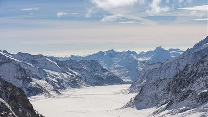 Wall Mural - Time lapse of snow mountain at Jungfrau in Switzerland