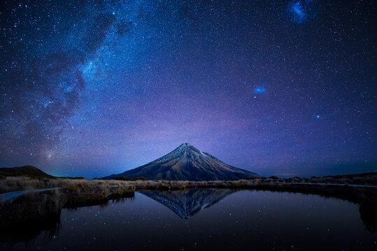 Night sky over Mt. Taranaki reflecting in Pouakai Pool, New Zealand