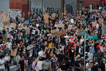 People take part in a Black Lives Matter protest in the Brooklyn borough of New York City