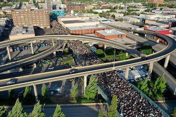 Protesters walk onto Morrison Bridge while rallying against the death in Minneapolis police custody of George Floyd, in Portland