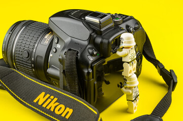 Bangkok, Thailand - March, 31, 2020 : Lego star wars stormtrooper looking into the viewfinder of nikon dslr camera.