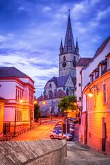 Fototapete - Sibiu, Romania, the german cathedral at night, Transylvania.