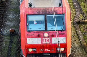 Close-up of a red railcar of Deutsche Bahn on the siding at the station in Wolfsburg, Germany, January 10., 2020