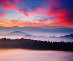 Wall Mural - Evening mountains landscape are illuminated by the sunset.