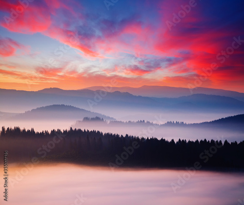 Wall mural Evening mountains landscape are illuminated by the sunset.