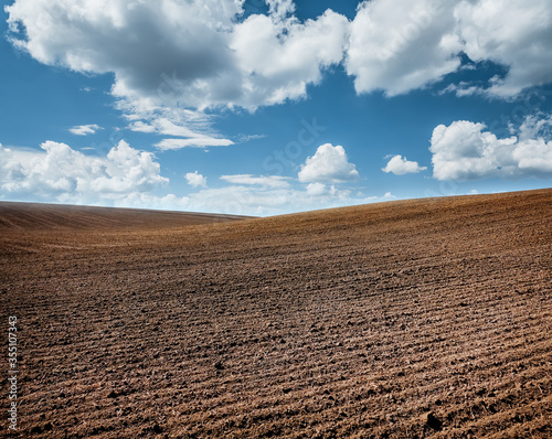 Wall mural Picturesque rural area and plowed field on the springtime.