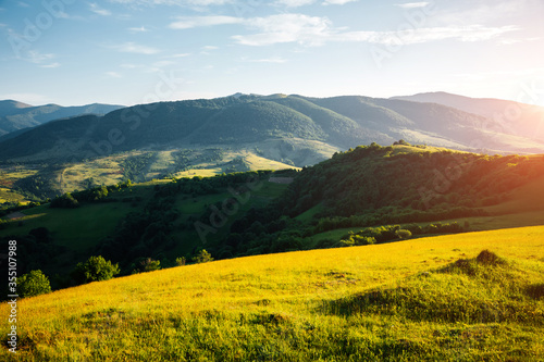 Wall mural Idyllic sunny day in tranquil mountain landscape. Location place of Carpathian mountains.