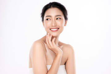 Portrait of a beautiful happy woman with a beautiful smile, clean and healthy skin and nude makeup on a white background. Cosmetology skin care and makeup