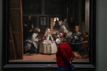 A member of the media stands next to Spanish artist Diego Velazquez's painting 'Las Meninas' as the Prado museum prepares for reopening on June 6th amid the coronavirus disease (COVID-19) outbreak, in Madrid
