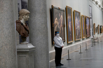 A museum worker wears a protective mask as the Prado museum prepares for reopening on June 6th amid the coronavirus disease (COVID-19) outbreak, in Madrid