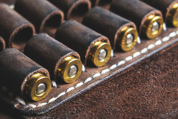 cartridges for 10 x 22 caliber pistol in brown genuine leather bandolier