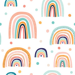 Trendy seamless baby pattern wit hand drawn rainbows. Vector illustrations. Summer colorful pattern design. Funny rainbows for Party decoration