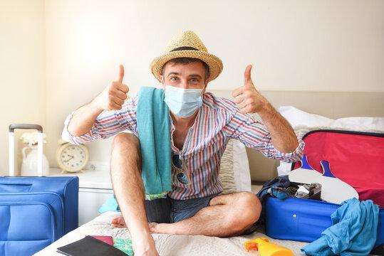 Man ready to travel ok gesture on holiday coronavirus season