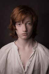 Classic painterly studio portrait of boy with red hair
