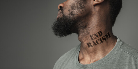 Close up black man tired of racial discrimination has tattooed slogan end racism on his neck. Concept of human rights, equality, justice, problem of violence and racism, discrimination. Flyer.