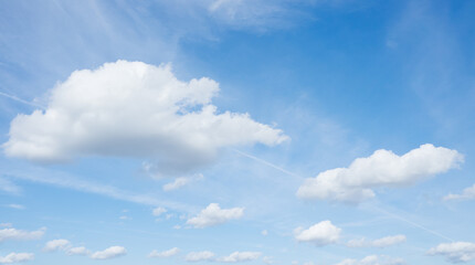 Beautiful blue sky and flying white clouds, no birds, nobody.
