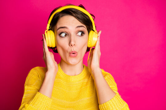 Portrait of astonished funny crazy girl have yellow headset listen unbelievable music impressed look copyspace wear jumper isolated over bright color background