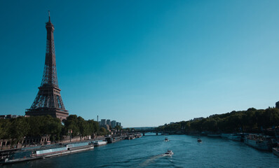 Wall Mural - Paris along the Seine River: An amazing area with plenty of beautiful points of interest: Eiffel Tower, Jeanne of Arc Statue, mini Statue of Liberty, The Seine River, the Lover's Bridge, the Barges,..