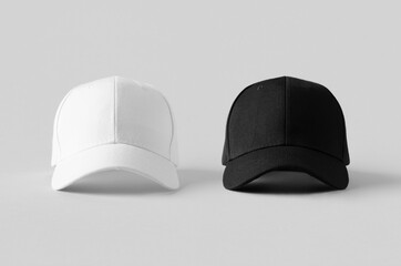 White and black baseball caps mockup on a grey background, front view.