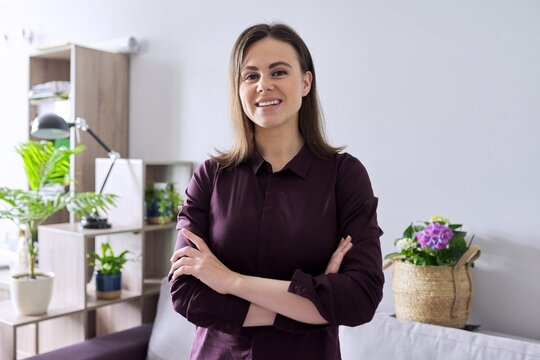 Portrait of smiling beautiful confident woman 25 years old looking at the camera