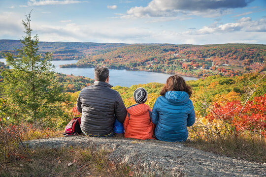 family taking in a scenic spot in the fall in New England