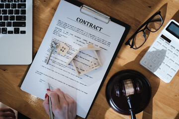 Lawyer checking agreement document before sending to client.