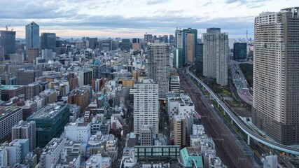 Wall Mural - Tokyo city skyline day to night time lapse.