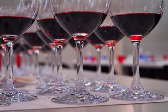 Close up view of rows of red wine glasses