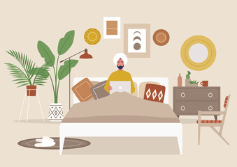 Cozy boho bedroom interior, young indian male character lying in bed with a laptop, flat editable vector illustration