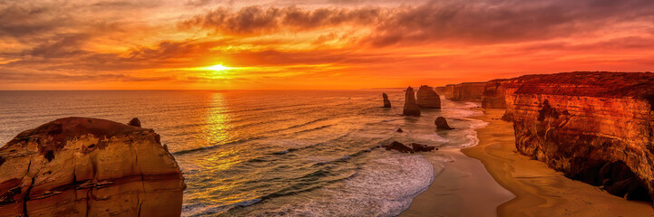 Poster Mer coucher du soleil The twelve (12) Apostels, a rock formation at the Grand Ocean Road in New South Wales (NSW), Australia at sunset in summer as a panorama.