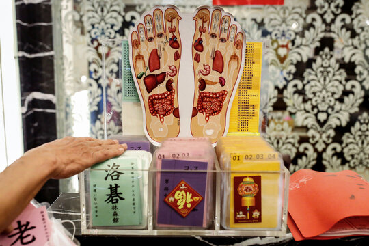 A staff shows hotel passes for drivers at a massage parlour that targets foreign tour groups in Taipei