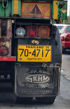 BANGKOK,  THAILAND, SEP 21 2019,The detailed look at back wheel of truck with mud flap, back lighting and registration number - car license plate.