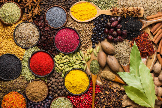 food background, spices and herbs for cooking tasty dishes. various seasonings scattered on table.