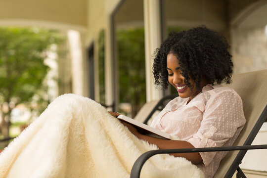 African American woman studing and reading the Bible.