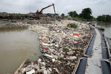 Waste collected by a log boom is seen on a river during World Environment Day, in Klang