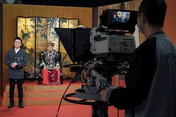 """Ng Chi-sam and Tsang Chi-ho, hosts of Radio Television Hong Kong (RTHK)'s satirical comedy show """"Headliner"""" perform the show, in Hong Kong"""