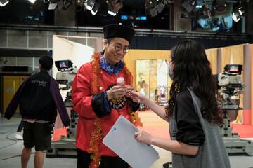 "Tsang Chi-ho, host of Radio Television Hong Kong (RTHK)'s satirical comedy show ""Headliner"" reacts during a show rehearsal, in Hong Kong"
