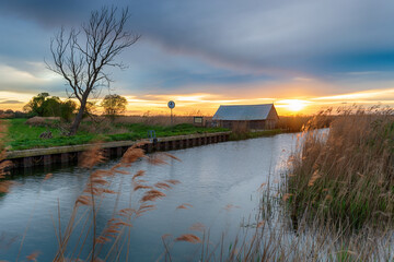 Wall Mural - Sunset over the river Thurne at West Somerton
