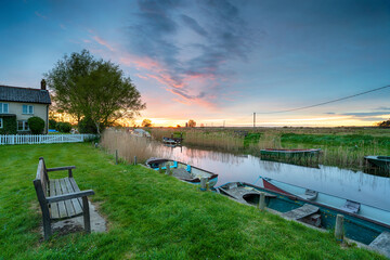 Wall Mural - Sunset over boats on the river at West Somerton