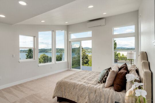 Restful bedroom interior with master bed placed under a sloped ceiling.