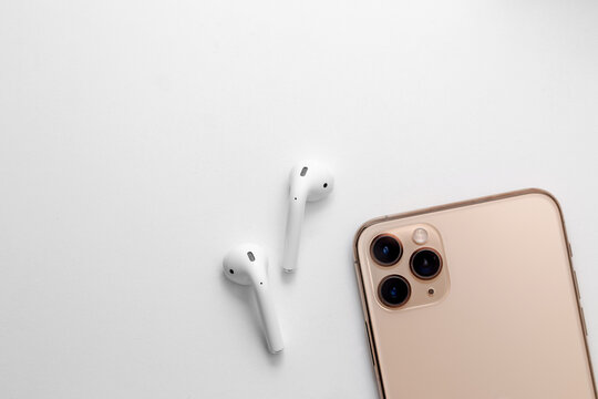 white wireless headphones on a background
