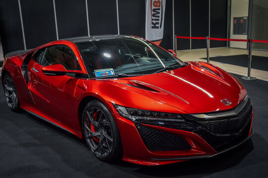 Luxury red sportcar exhibited on motor show.