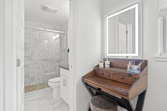 Elegant master bathroom and a freestanding makeup vanity