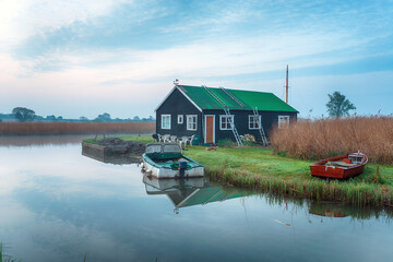 Wall Mural - Early morning on the river Thurne