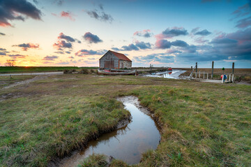 Wall Mural - Sunset over the old coal barn at Thornham