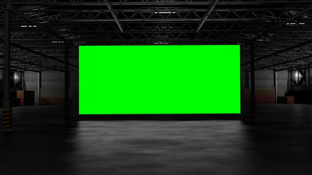 3d rendering of dark empty factory interior or empty warehouse, a green screen backdrop in the middle